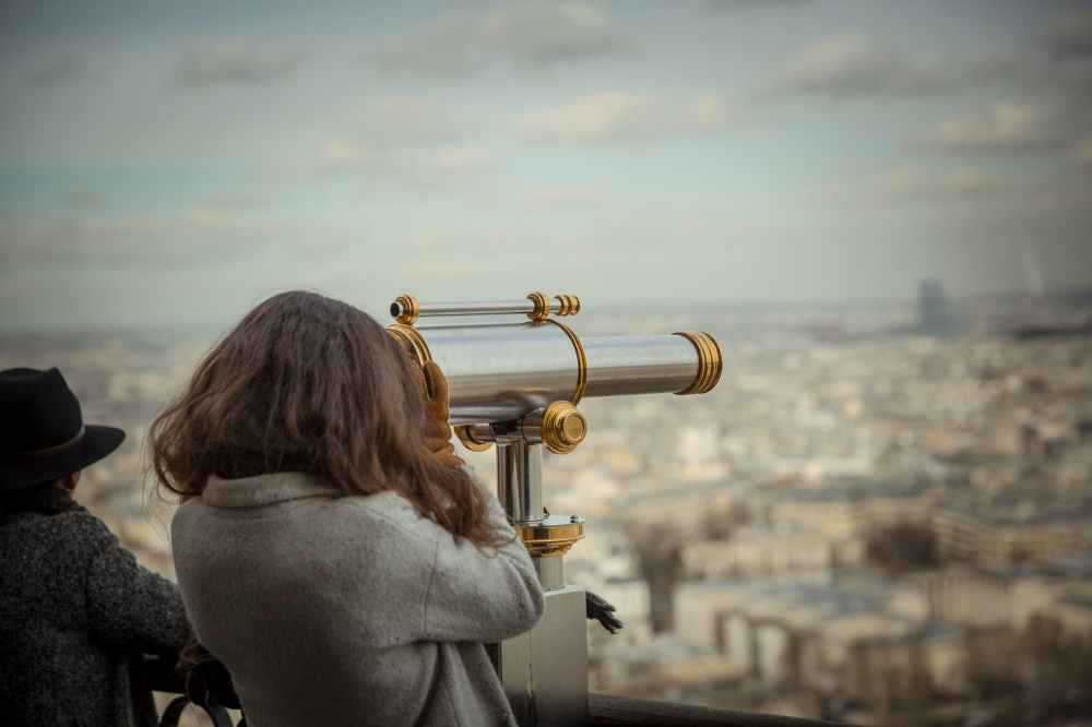 person using telescope
